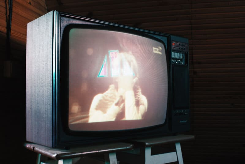 Picture of an old TV. Digging out some old TV shows from youtube can be a great way to reminisce with your loved one.