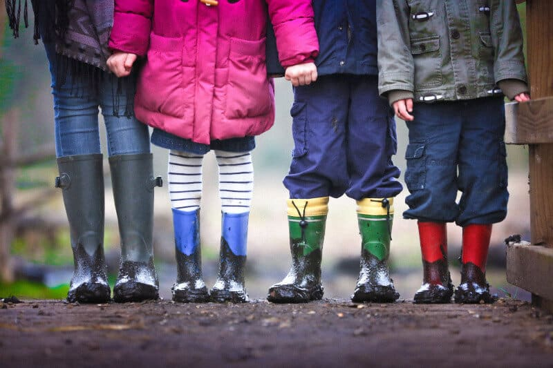 Picture of some kids in wellies. Interacting with their grandkids can be good for elderly people.